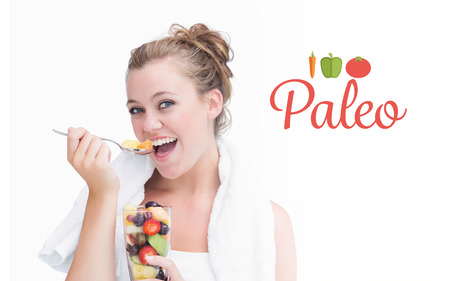 tied hair: The word paleo against woman eating fruit and smiling