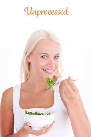 unprocessed: The word unprocessed against smiling woman eating salad