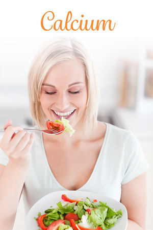 eating salad: The word calcium against blonde woman eating salad