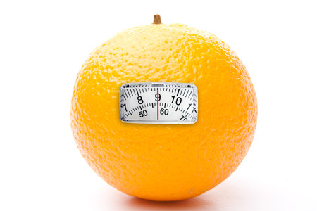 weighing scales: weighing scales against one orange