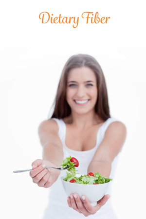 dietary fiber: The word dietary fiber against delicious salad being eaten by a young woman Stock Photo