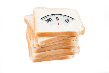 weighing scales: weighing scales against stack of white bread