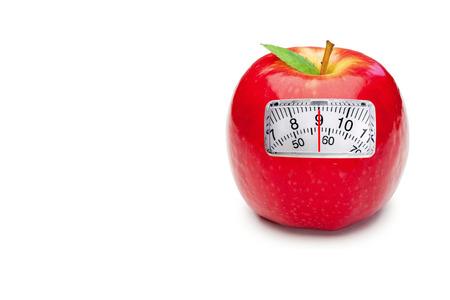 weighing scales: weighing scales against red apple