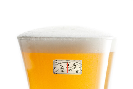 weighing scales: weighing scales against glass of beer