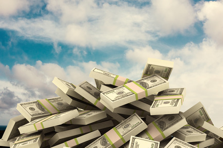 pile of money: Pile of dollars against blue sky with white clouds