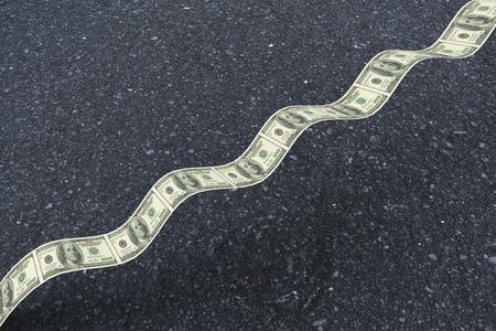 bumpy: Bumpy dollar road against black