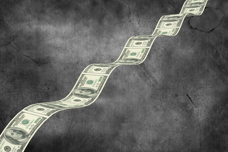 bumpy: Bumpy dollar road against dark background