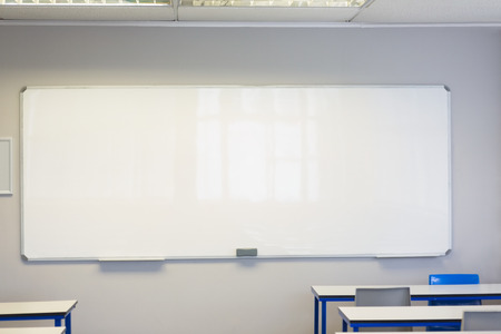 empty classroom: Empty classroom in the college with large white board Stock Photo