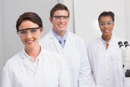 scientist: Scientists smiling and looking at camera in laboratory
