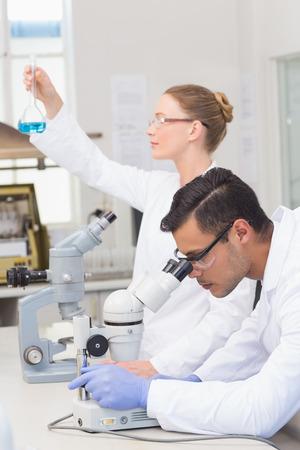 precipitate: Scientists examining blue precipitate in the laboratory Stock Photo