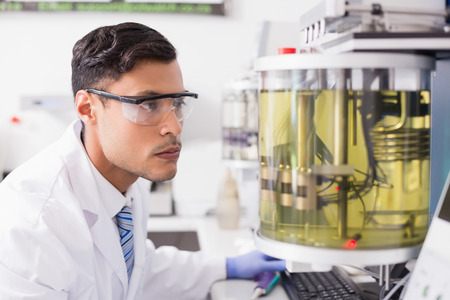concentrated: Concentrated scientist working in laboratory