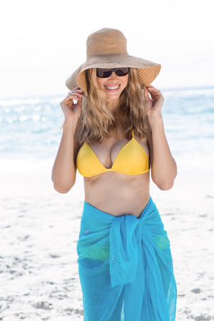 fair woman: Smiling pretty blonde wearing sun glasses at the beach Stock Photo
