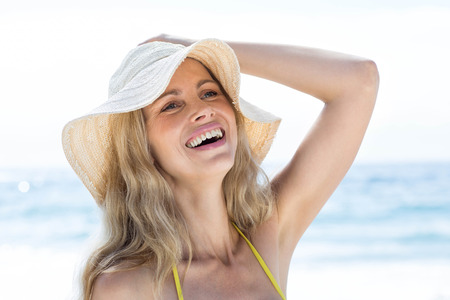 fair woman: Smiling pretty blonde enjoying the sun at the beach