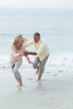 couple having fun: Happy couple having fun together at the beach