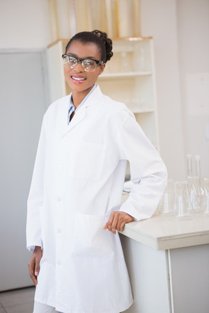 biochemist: Smiling scientist looking at camera in laboratory