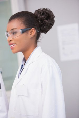 protective glasses: Smiling scientist wearing protective glasses in laboratory Stock Photo