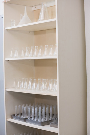 storage unit: Storage unit with test tubes and beakers in laboratory