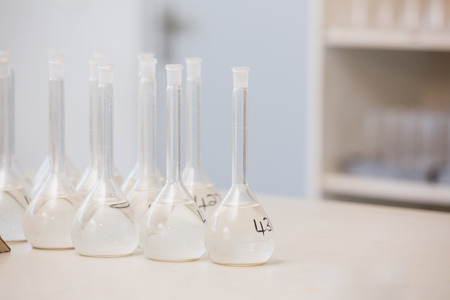 beakers: Numbered beakers in laboratory Stock Photo