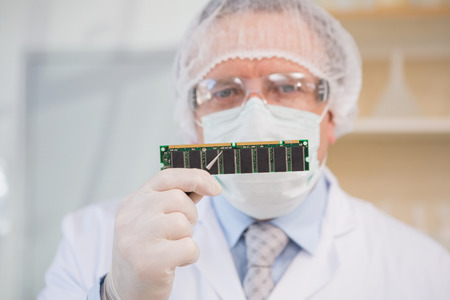 electronic card: Engineer holding electronic card in the laboratory