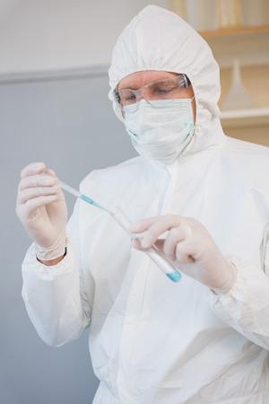 precipitate: Scientist injecting tube in the laboratory