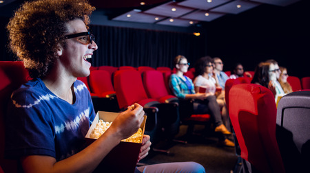 3d film: Young friends watching a 3d film at the cinema Stock Photo