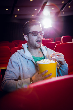 3d film: Young man watching a 3d film at the cinema Stock Photo