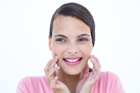 Pretty brunette with teeth pain on white background