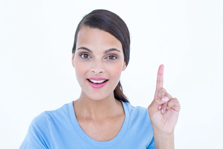 Beautiful brunette woman having an idea on white background photo