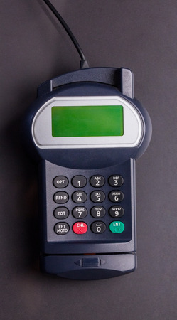 pin entry: Overhead of pin terminal machine against grey background