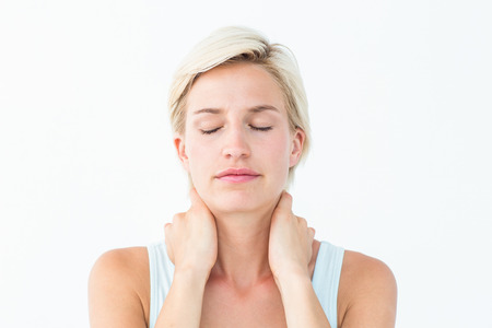 dolor  muscular: Woman with eyes closed suffering from neck ache on white background