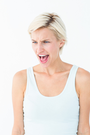 outraged: Upset blonde screaming on white background