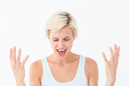 angry blonde: Angry blonde yelling with hands up on white background
