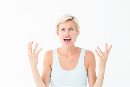 yelling: Angry blonde yelling with hands up on white background