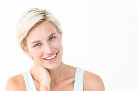 on a white background: Gorgeous blonde smiling ta camera on white background Stock Photo