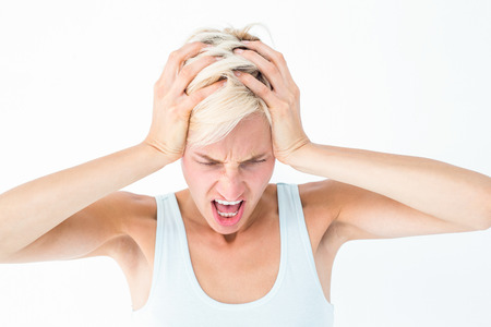 angry blonde: Angry blonde woman screaming and holding her head on white background