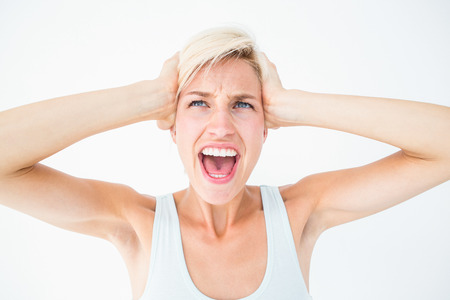 angry blonde: Angry blonde screaming and holding her head on white background