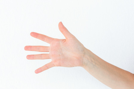 woman white background: Woman showing her hand on white background