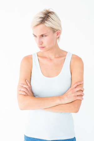 angry blonde: Angry blonde with arms crossed on white background