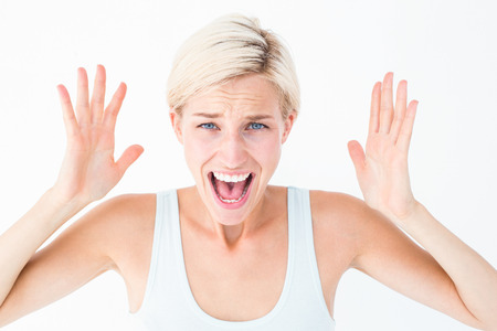 wrath: Angry blonde screaming with hands up on white background