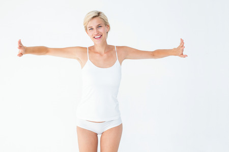 arms out: Happy woman smiling at camera with arms out on white background