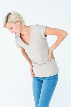 Woman suffering from back pain on white background