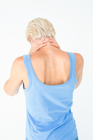 health fair: Casual woman suffering from neck ache on white background