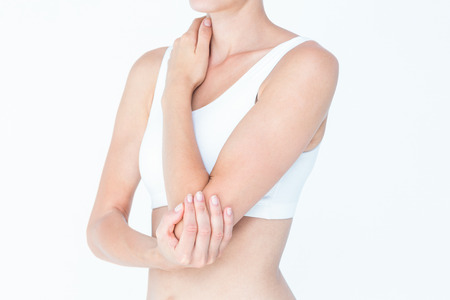 elbow pain: Woman suffering from elbow pain on white background