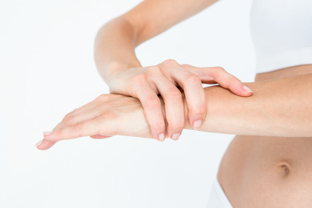 cut wrist: Woman with wrist pain on white background