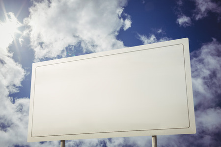 billboard: Billboard sign with copy space against cloudy blue sky Stock Photo