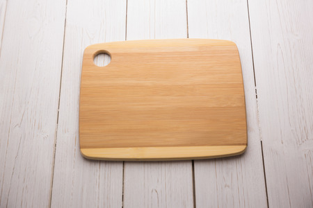 Chopping board on wooden table shot in studio