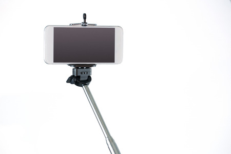 outs: Smartphone on a selfie stick shot in studio Stock Photo