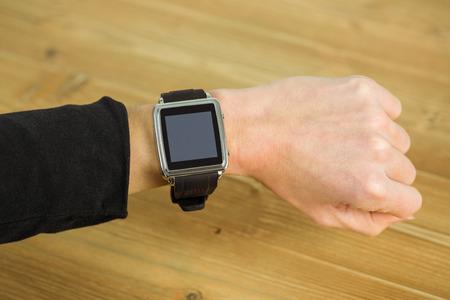 cut wrist: Businesswoman with smart watch on wrist shot in studio