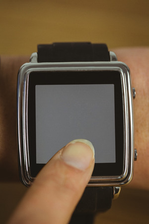 cut out device: Businesswoman with smart watch on wrist shot in studio