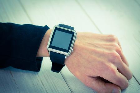 cut wrist: Businesswoman using a smart watch shot in studio